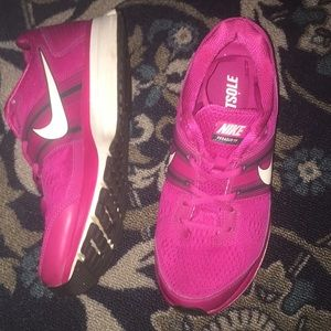 Pink women's Nike shoes 8.5